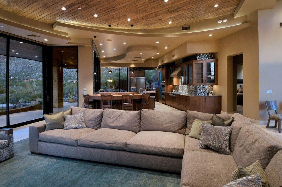 Эффектный многоуровневый потолок комбинированный деревом