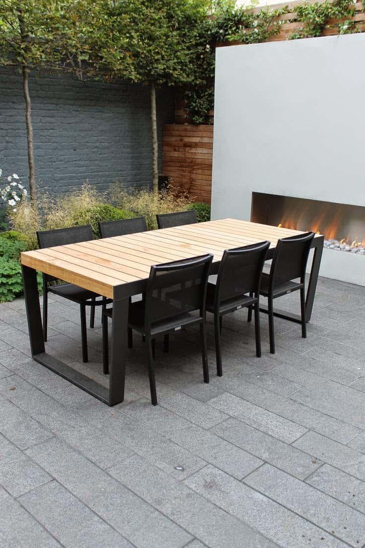 Красивый стол из дерева и металла выполненный в современном стиле