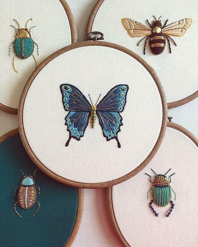Красивая, яркая бабочка вышитая гладью, эффектно смотрится на фоне других представителей мира насекомых