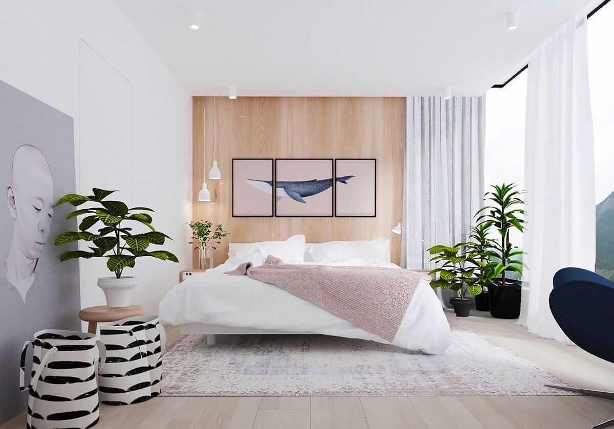 Белоснежные тона спальни в сочетании с комнатными растениями создают атмосферу гармонии и спокойствия