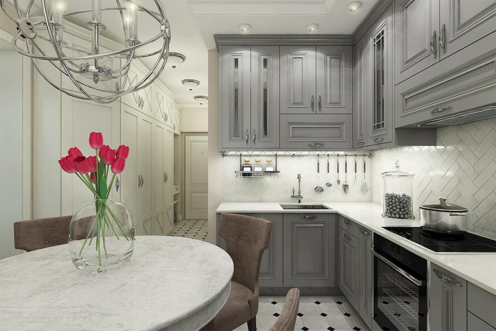 Un luxueux lustre design est l'attribut principal de l'intérieur d'une cuisine classique.