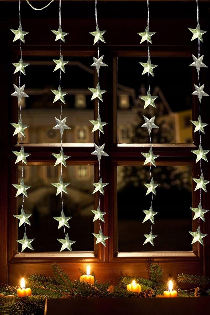 Изящная новогодняя гирлянда из красивых светодиодных звездочек, спадающих вниз