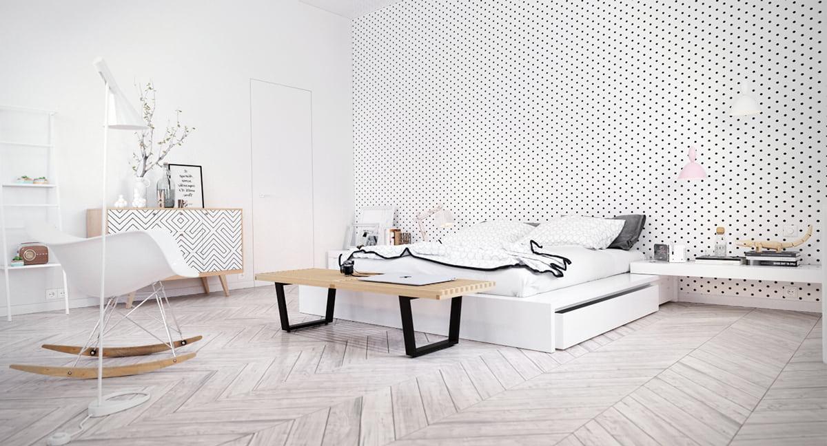 Un beau papier peint blanc à pois constitue un accent élégant sur l'un des murs.