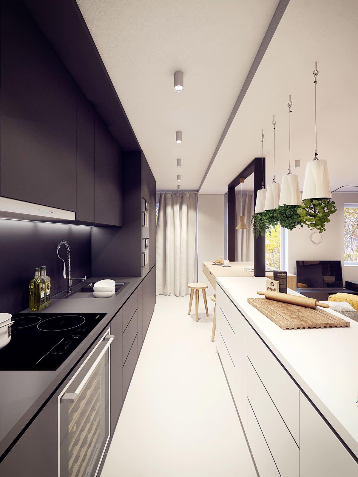 Pour ceux qui n'aiment pas la monotonie dans leur intérieur, une option intéressante serait un design inhabituel d'une cuisine étroite, divisée en deux zones utilisant le noir et le blanc.