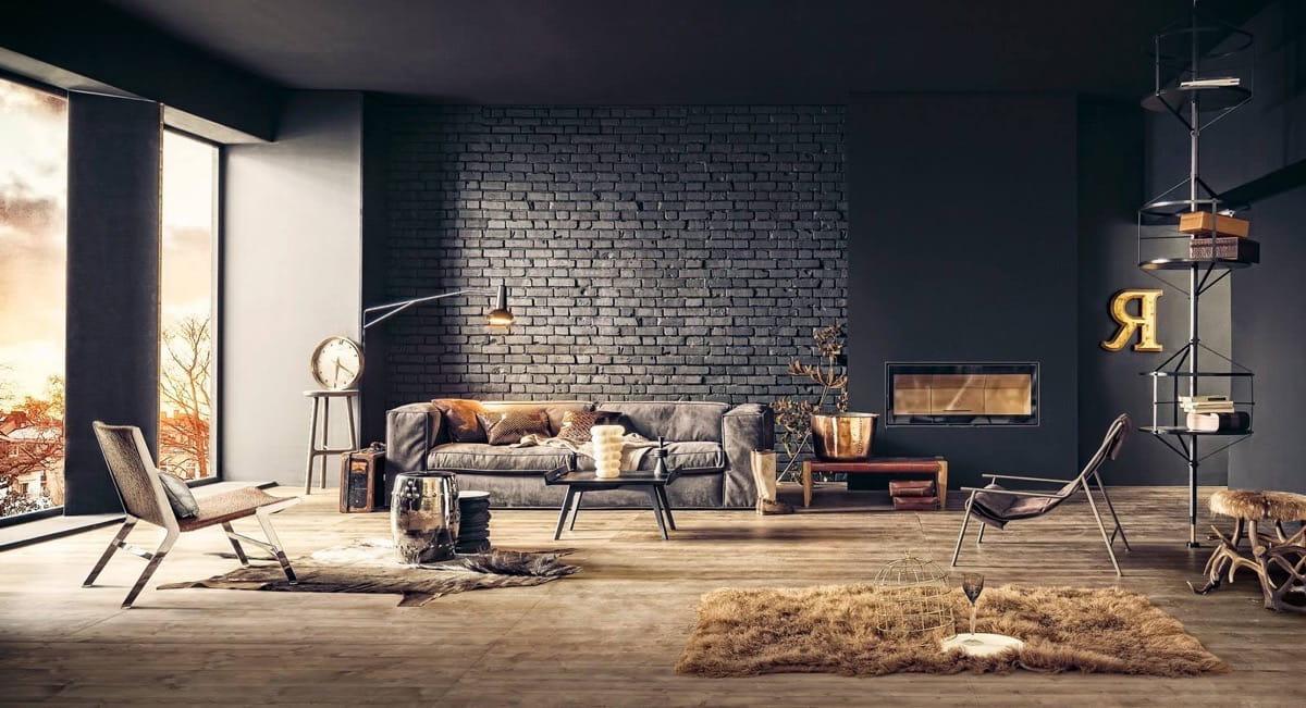 Design de salon austère avec un canapé confortable et un mur de briques sombres qui s'intègre parfaitement dans le concept global du style loft
