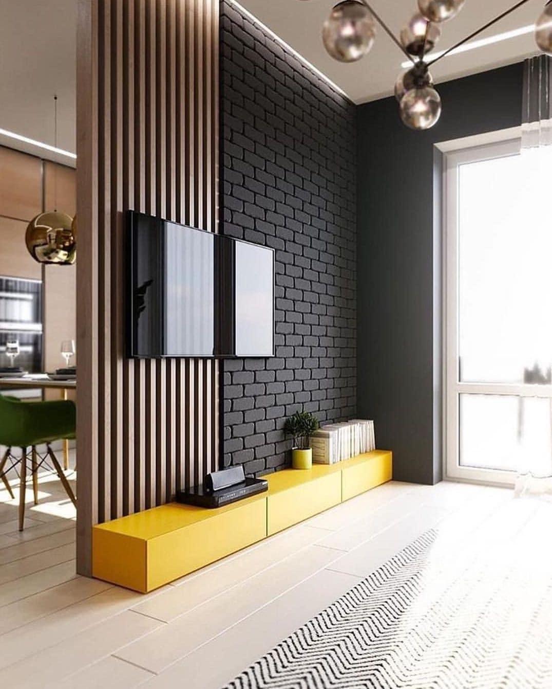 La cloison combinée en bois et en brique s'intègre parfaitement à tout intérieur.