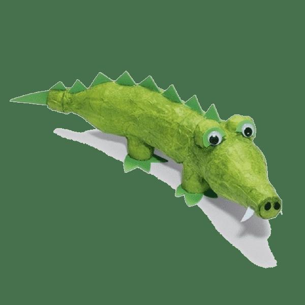 Соединив между собой две пластиковые бутылки и обмотав их фольгированной цветной бумагой можно получить забавного крокодила