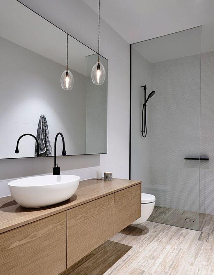 Утонченный и изысканный минималистический дизайн ванной в светлых тонах