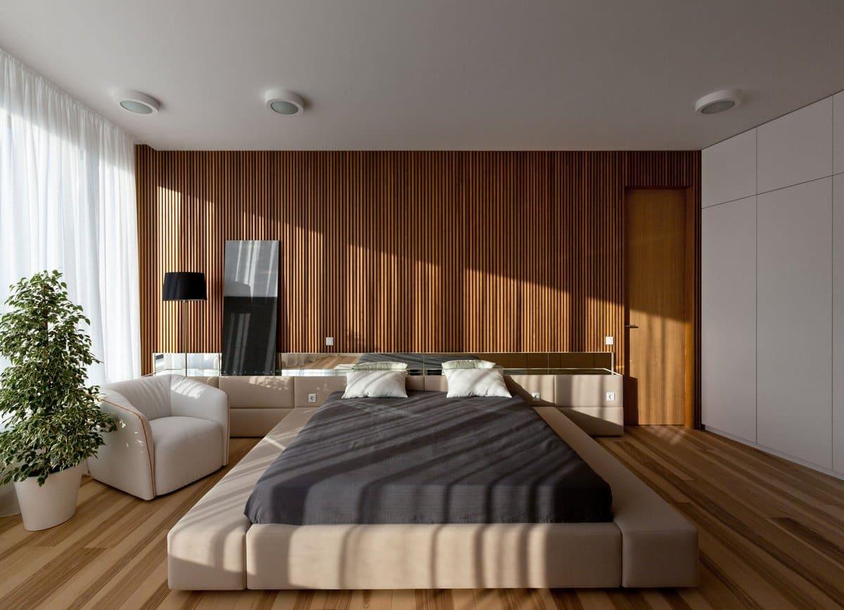 Красивая спальня с большим количеством естественного освещения и натуральных материалов в отделке