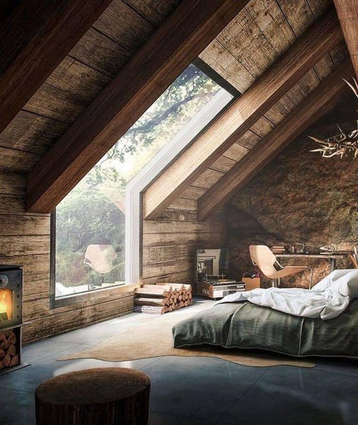 Спальня организованная на мансардном этаже отличается особой атмосферой комфорта