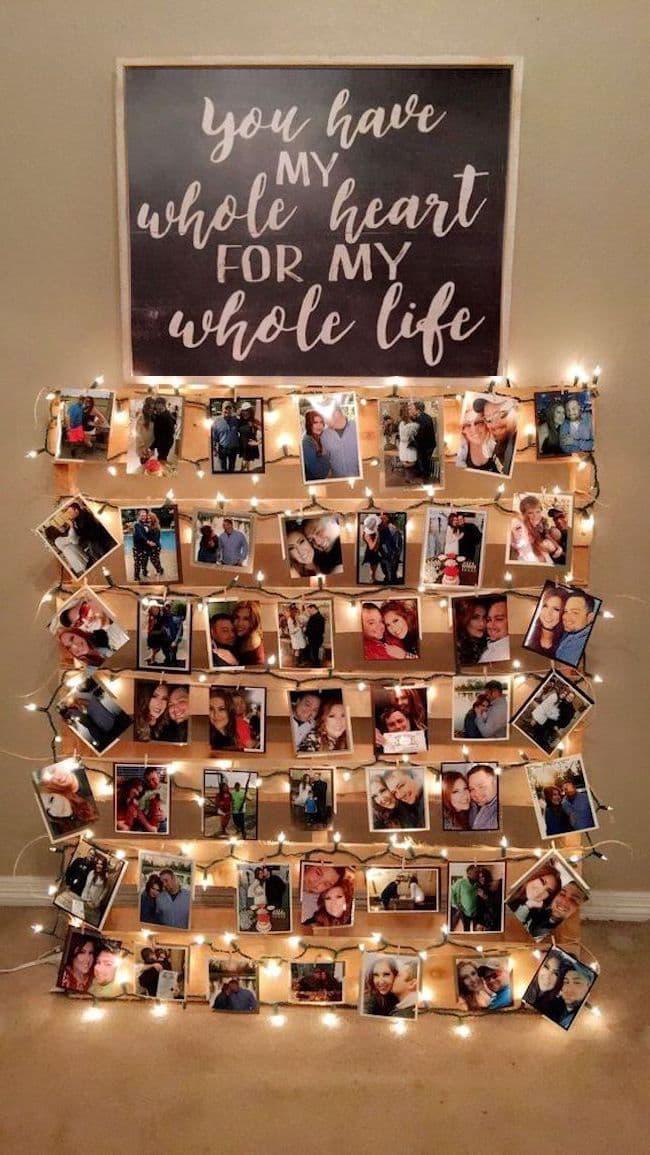 Необычное использование деревянного поддона в качестве основы для крепления семейных фотографий