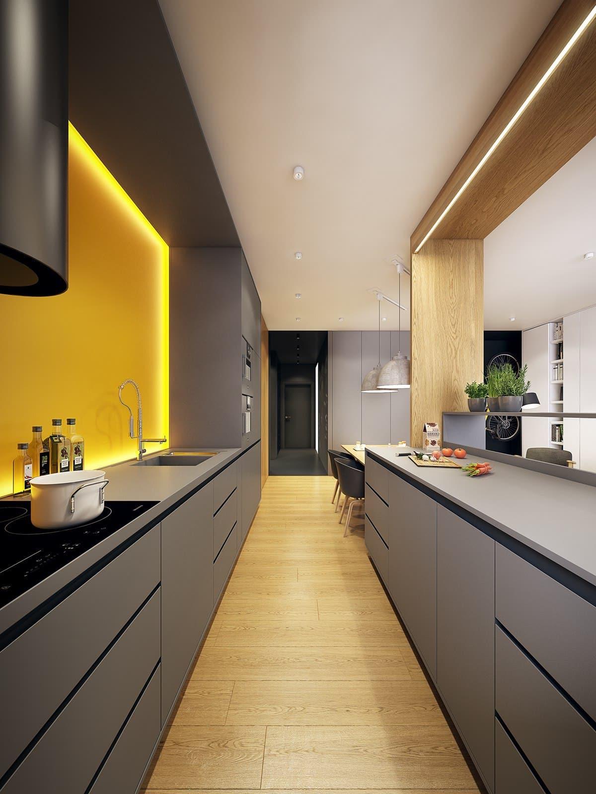 Современный дизайн узкой кухни в нежных желто-серых оттенках