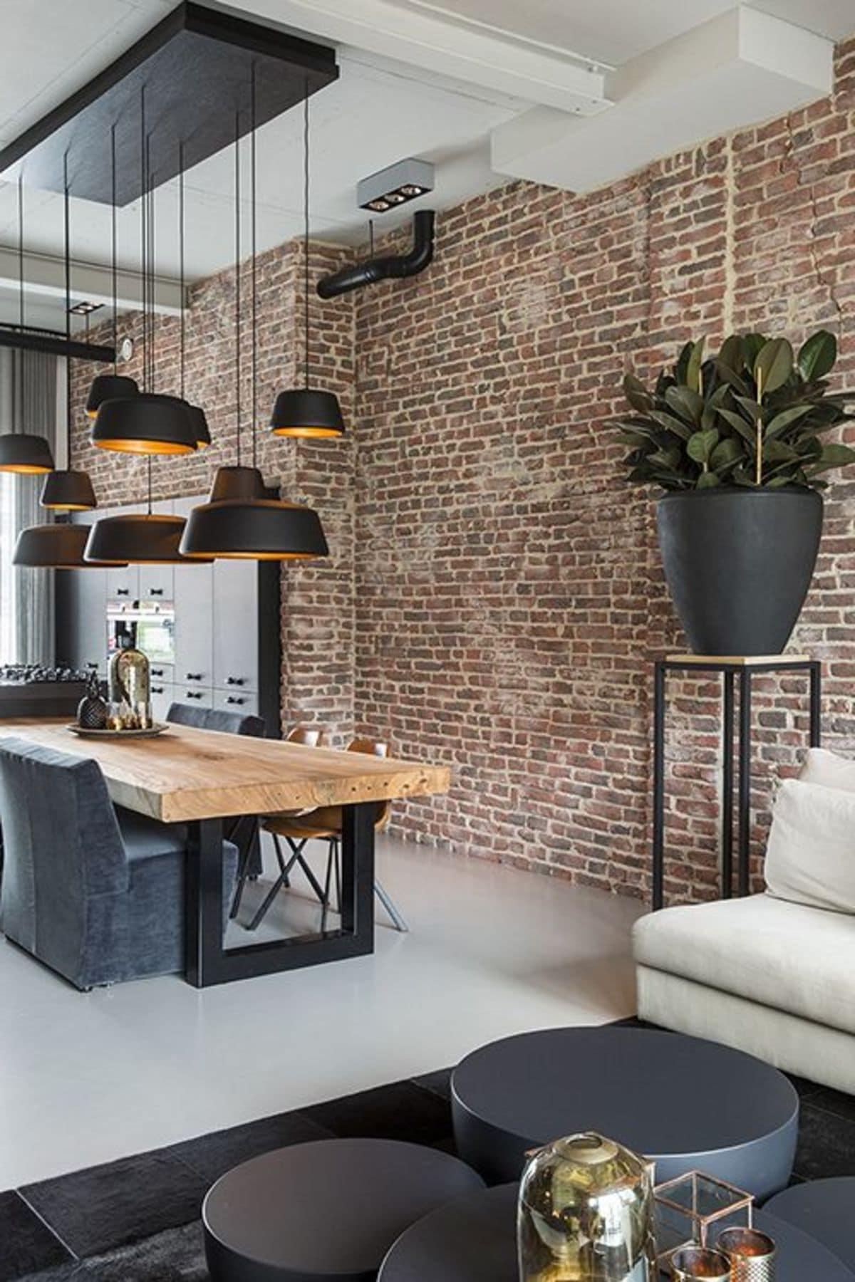 Большие подвесные лампы гармонирует с остальными элементами декора в черном цвете