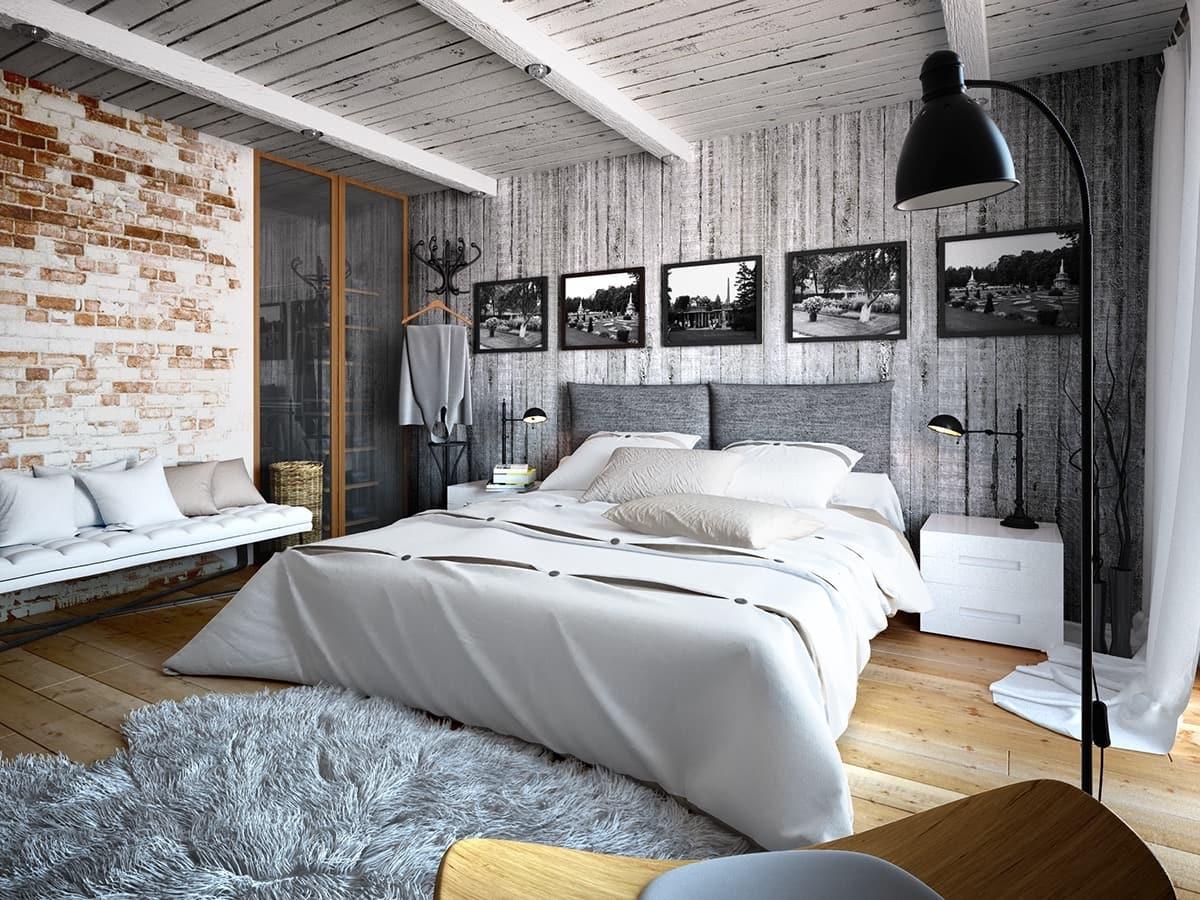 Центральная часть этой спальни в стиле лофт – выбеленный деревянный потолок с выступающими балками