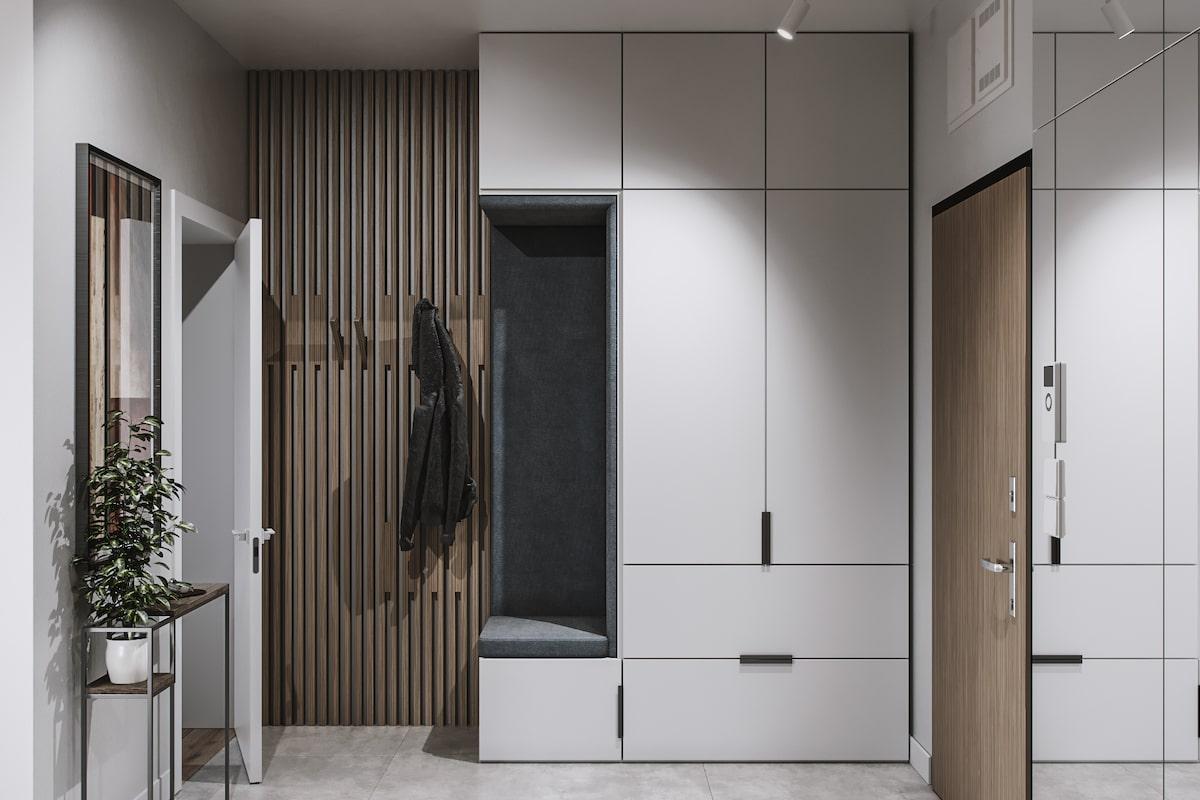 Для декорирования стен в прихожей очень часто используют деревянные рейки